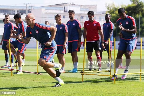 Esteban Cambiasso and team mates exercise during a Olympiacos FC training session ahead of their UEFA Champions League Group F match against Bayern...
