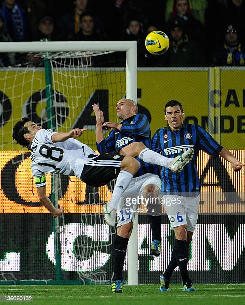 Esteban Cambiasso of FC Inter Milan and Marco Parolo of AC Cesena compete for the ball during the Serie A match between AC Cesena and FC...