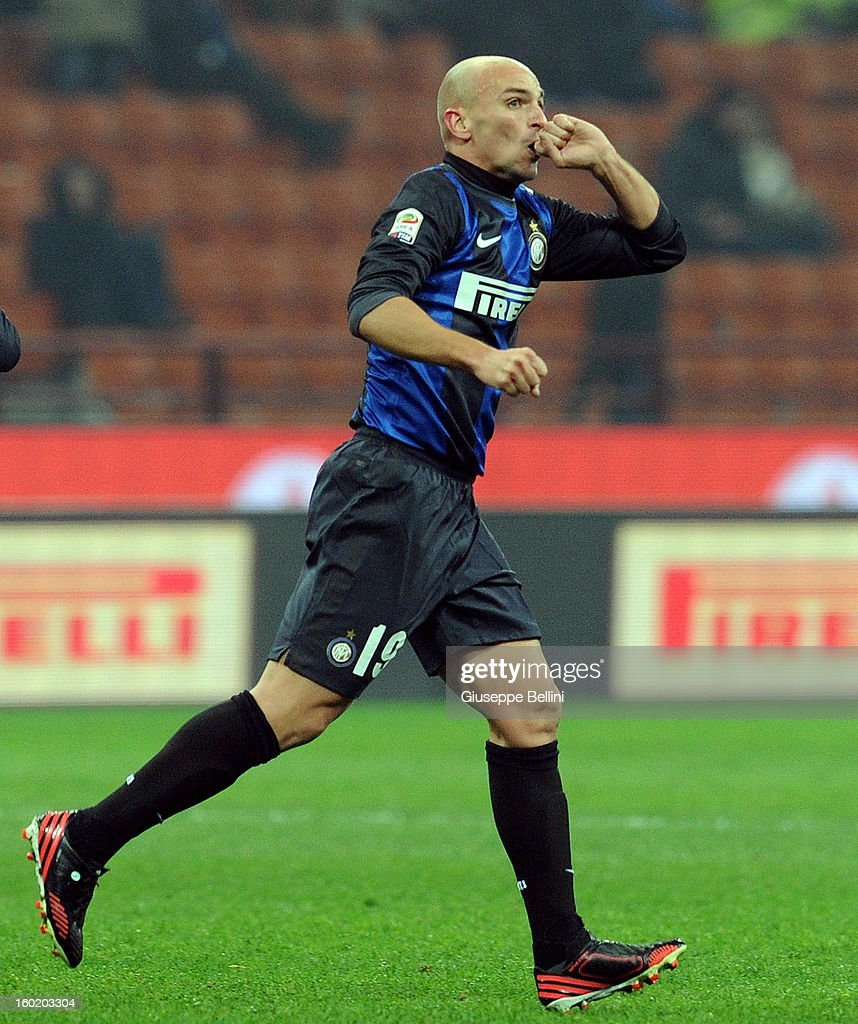 <a gi-track='captionPersonalityLinkClicked' href=/galleries/search?phrase=Esteban+Cambiasso&family=editorial&specificpeople=213561 ng-click='$event.stopPropagation()'>Esteban Cambiasso</a> of Inter celebrates after scoring the goal 2-2 during the Serie A match between FC Internazionale Milano and Torino FC at San Siro Stadium on January 27, 2013 in Milan, Italy.