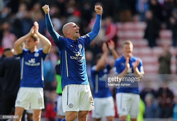 Esteban Cambiasso of Leicester City celebrates avoiding relegation