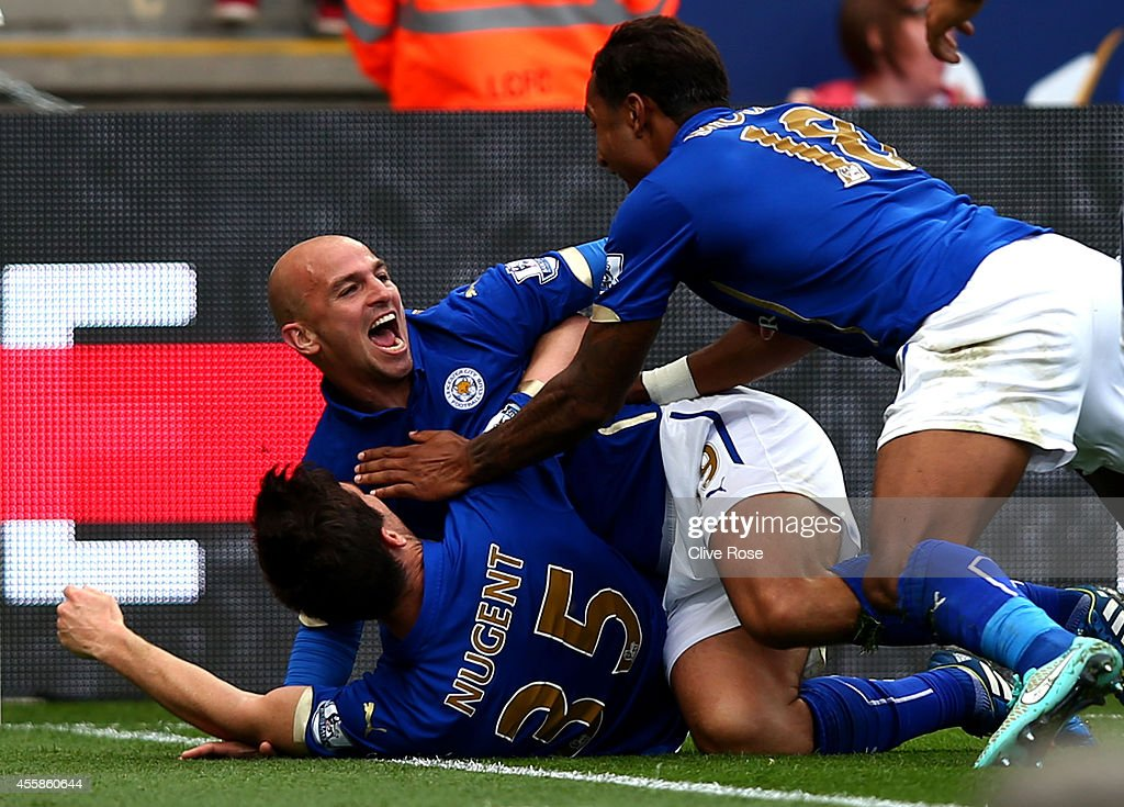 <a gi-track='captionPersonalityLinkClicked' href=/galleries/search?phrase=Esteban+Cambiasso&family=editorial&specificpeople=213561 ng-click='$event.stopPropagation()'>Esteban Cambiasso</a> of Leicester City celebrates with <a gi-track='captionPersonalityLinkClicked' href=/galleries/search?phrase=David+Nugent+-+Soccer+Player&family=editorial&specificpeople=644849 ng-click='$event.stopPropagation()'>David Nugent</a> and Liam Moore of Leicester City after scoring his team's third goal during the Barclays Premier League match between Leicester City and Manchester United at The King Power Stadium on September 21, 2014 in Leicester, England.