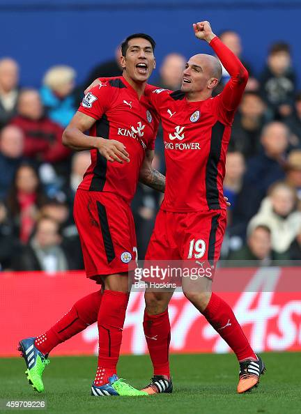 Esteban Cambiasso of Leicester City celebrates with teammate Leonardo Ulloa of Leicester City after scoring the opening goal during the Barclays...