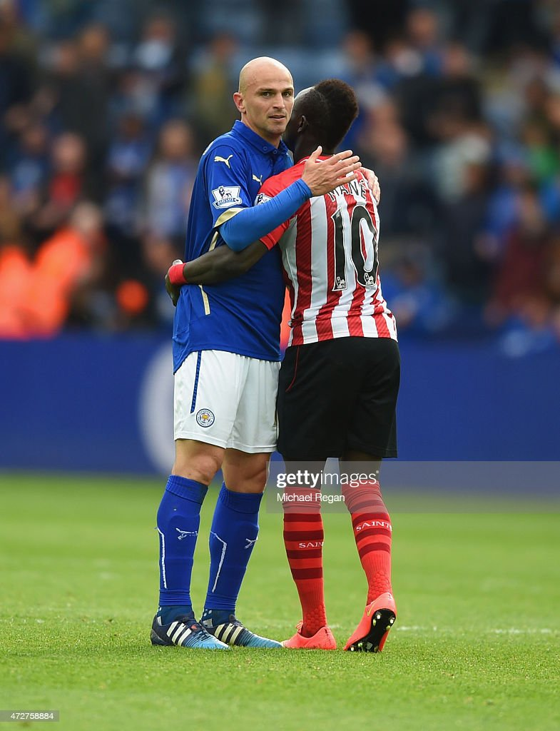 Esteban Cambiasso of Leicester City embraces Sadio Mane of Southampton as he celebrates victory after the Barclays Premier League match between Leicester City and Southampton at The King Power Stadium on May 9, 2015 in Leicester, England.