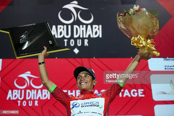 Esteban Chaves of Colombia and Orica Greenedge wearing the general time classification red jersey celebrates on the podium after winning the 2015 Abu...
