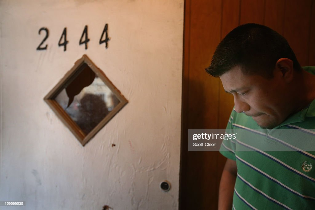 Esteban Dorantes stands next to the front door of his home damaged with bullet holes on January 12, 2013 in Chicago, Illinois. Esteban's 14-year-old son Rey Dorantes was shot and killed while sitting on the porch in front of the home the night before. Dorantes, who was one of 6 teenagers shot in Chicago on January 11, became the 21st homicide in the city for 2013. In 2012 Chicago had more than 500 homicides.