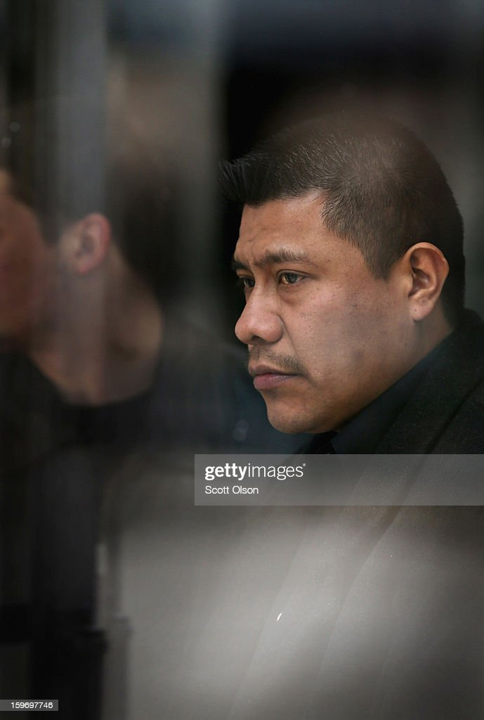 Esteban Dorantes, the father of Rey Dorantes, watches from inside St. Mark Church for a hearse to arrive with the remains of his son Rey on January 18, 2013 in Chicago, Illinois. Rey Dorantes, 14, died after being shot six times while he was sitting on the front porch of his home while talking on the phone on January 11. Dorantes' murder was the 21st homicide recorded in Chicago for 2013, a city which saw more than 500 homicides in 2012.