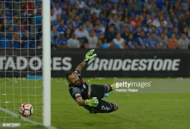 Esteban Dreer of Emelec fails to stop a shot by Fernando Belluschi of San Lorenzo during a first leg match between Emelec and San Lorenzo as part of...
