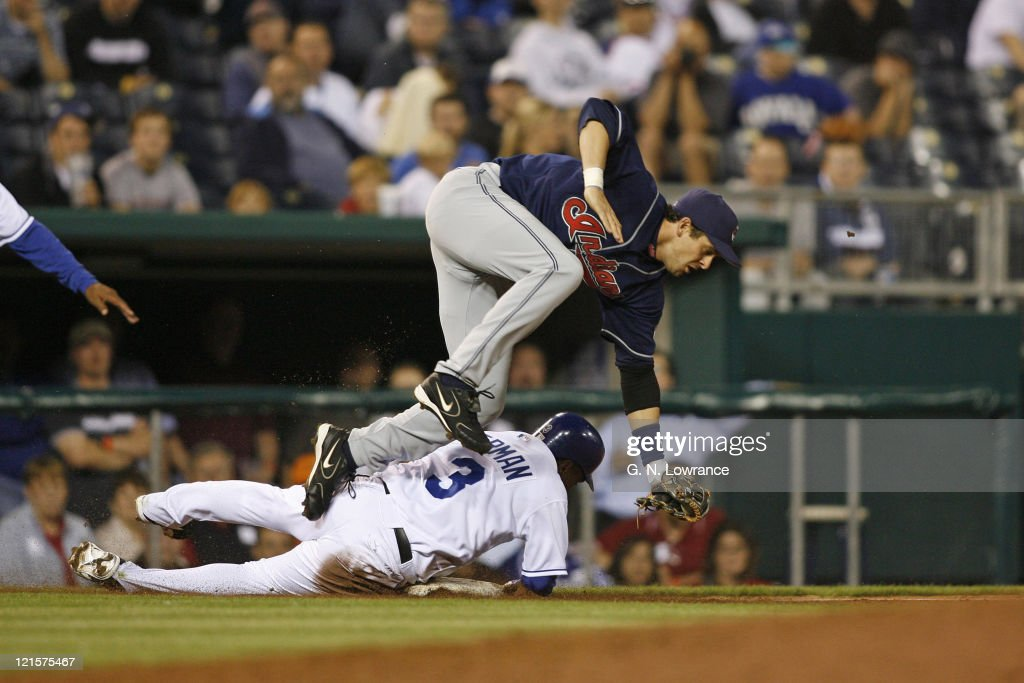 Esteban German of the Royals slides into 3rd base ahead of the throw as Cleveland's <a gi-track='captionPersonalityLinkClicked' href=/galleries/search?phrase=Aaron+Boone&family=editorial&specificpeople=211224 ng-click='$event.stopPropagation()'>Aaron Boone</a> flies over him during action between the Cleveland Indians and Kansas City Royals at Kauffman Stadium in Kansas City, Missouri on May 8, 2006. The Royals won 4-3.