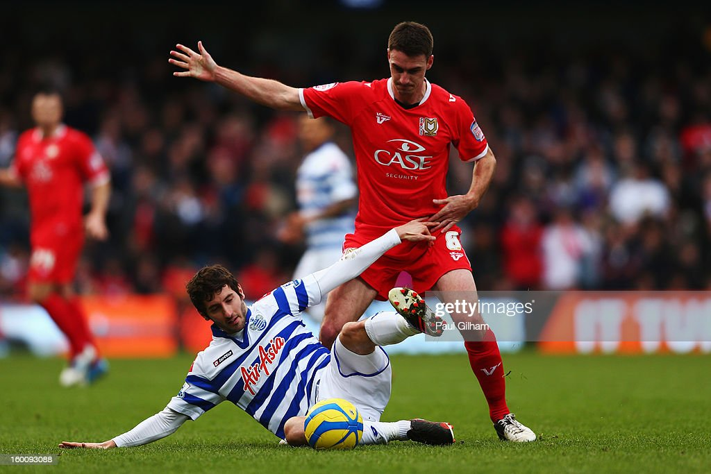 Esteban Granero of Queens Park Rangers holds off the challenge of Darren Potter of Milton Keynes Dons during the FA Cup with Budweiser Fourth Round match between Queens Park Rangers and Milton Keynes Dons at Loftus Road on January 26, 2013 in London, England.