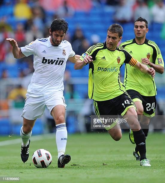 Esteban Granero of Real Madrid is challenged by Gabi of Real Zaragoza during the La Liga between Real Madrid and Real Zaragona at Estadio Santiago...