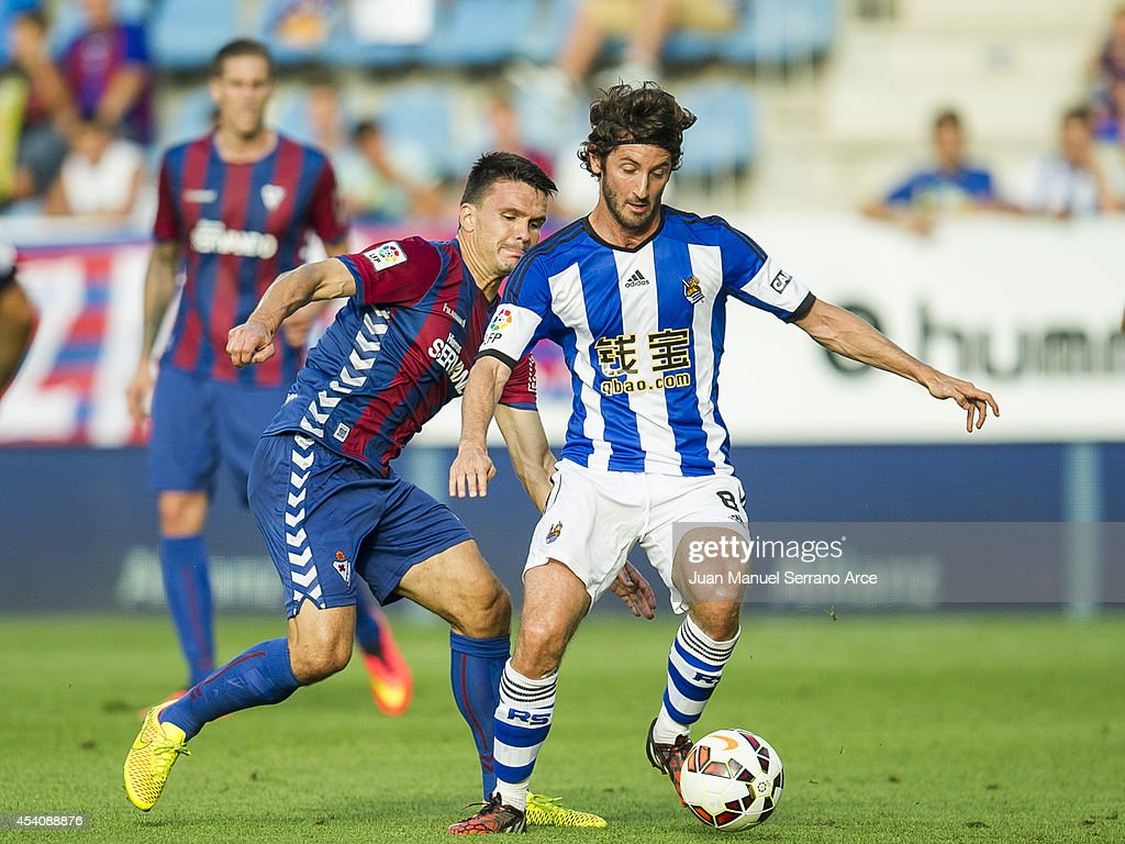 <a gi-track='captionPersonalityLinkClicked' href=/galleries/search?phrase=Esteban+Granero&family=editorial&specificpeople=4346782 ng-click='$event.stopPropagation()'>Esteban Granero</a> of Real Sociedad duels for the ball with Jon Errasti of SD Eibar during the La Liga match between SD Eibar and Real Sociedad at Ipurua Municipal Stadium on August 24, 2014 in Eibar, Spain.