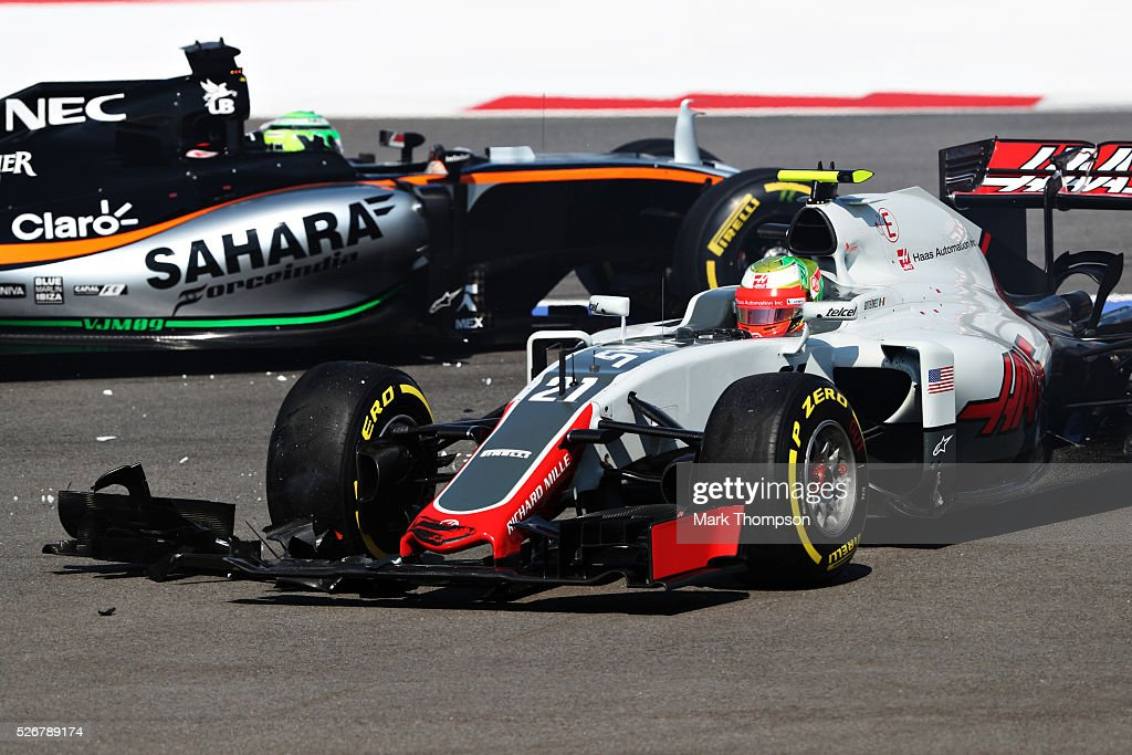 Esteban Gutierrez of Mexico driving the (21) Haas F1 Team Haas-Ferrari VF-16 Ferrari 059/5 turbo and<a gi-track='captionPersonalityLinkClicked' href=/galleries/search?phrase=Nico+Hulkenberg&family=editorial&specificpeople=2566799 ng-click='$event.stopPropagation()'>Nico Hulkenberg</a> of Germany driving the (27) Sahara Force India F1 Team VJM09 Mercedes PU106C Hybrid turbo in the run off area after colliding at the start during the Formula One Grand Prix of Russia at Sochi Autodrom on May 1, 2016 in Sochi, Russia.