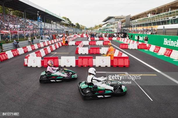 Esteban Ocon of France and Force India and Michel Salgado of Spain go head to head during the Heineken Champions of the Grid gokart race ahead of the...