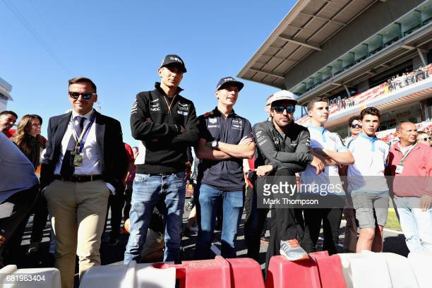 Esteban Ocon of France and Force India Max Verstappen of Netherlands and Red Bull Racing Fernando Alonso of Spain and McLaren Honda and others watch...