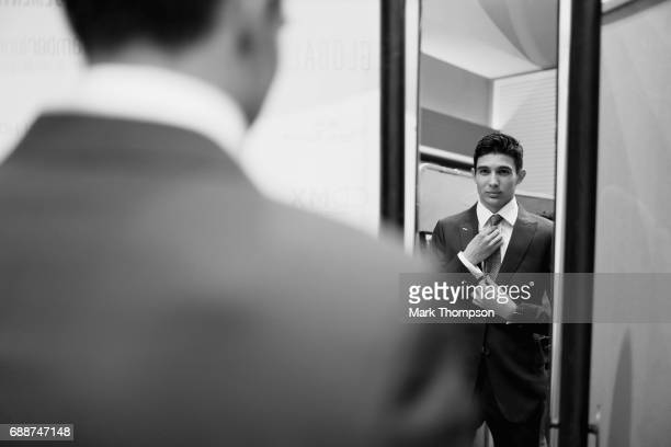 Esteban Ocon of France and Force India prepares for the Amber Lounge fashion show backstage during previews to the Monaco Formula One Grand Prix at...