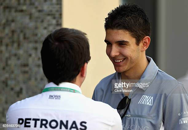 Esteban Ocon of France and Manor Racing talks in the Paddock during previews for the Abu Dhabi Formula One Grand Prix at Yas Marina Circuit on...
