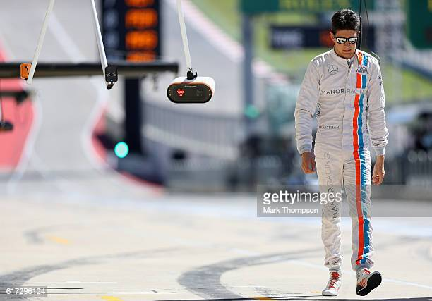 Esteban Ocon of France and Manor Racing walks in the Paddock during qualifying for the United States Formula One Grand Prix at Circuit of The...