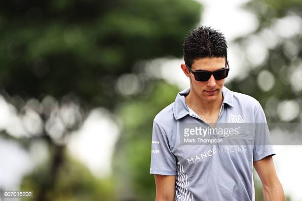 Esteban Ocon of France and Manor Racing walks into the paddock before final practice for the Formula One Grand Prix of Singapore at Marina Bay Street...
