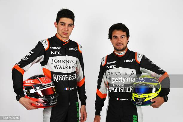 Esteban Ocon of France and Sahara Force India and Sergio Perez of Mexico and Sahara Force India pose after unveiling the VJM10 car during the Sahara...