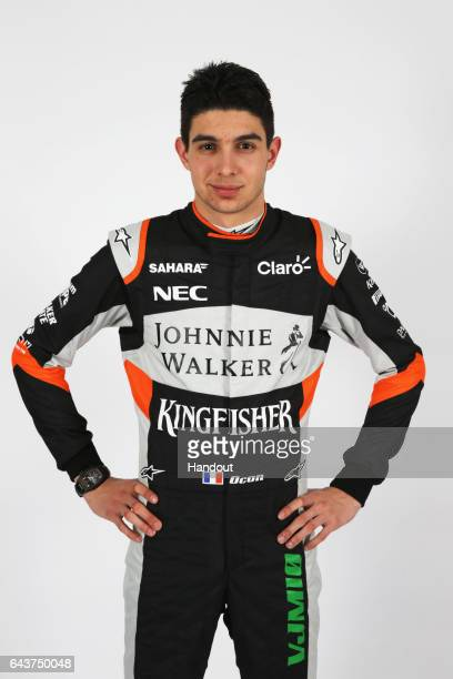 Esteban Ocon of France and Sahara Force India poses after unveiling the VJM10 car during the Sahara Force India Formula One team launch at...