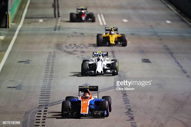 Esteban Ocon of France driving the Manor Racing MRTMercedes MRT05 Mercedes PU106C Hybrid turbo leads Valtteri Bottas of Finland driving the Williams...