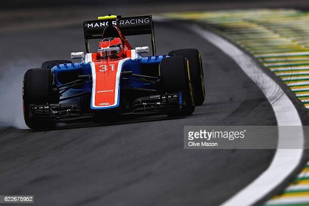 Esteban Ocon of France driving the Manor Racing MRTMercedes MRT05 Mercedes PU106C Hybrid turbo locks a wheel under braking on track during final...