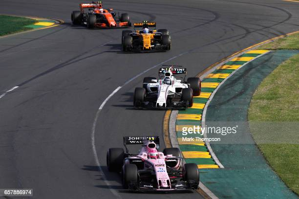 Esteban Ocon of France driving the Sahara Force India F1 Team VJM10 leads Lance Stroll of Canada driving the Williams Martini Racing Williams FW40...
