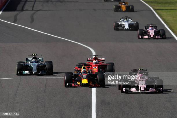 Esteban Ocon of France driving the Sahara Force India F1 Team VJM10 Daniel Ricciardo of Australia driving the Red Bull Racing Red BullTAG Heuer RB13...
