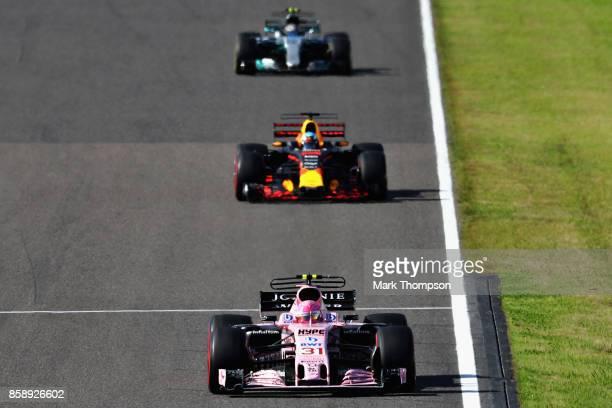 Esteban Ocon of France driving the Sahara Force India F1 Team VJM10 leads Daniel Ricciardo of Australia driving the Red Bull Racing Red BullTAG Heuer...