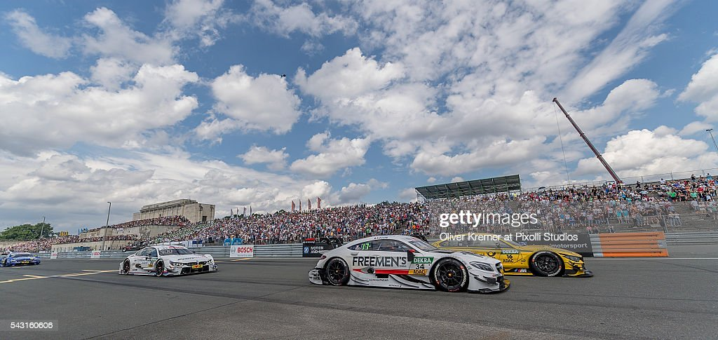 Esteban Ocon (FRA) of Mercedes-AMG DTM Team Art and Timo Klock (GER) of BMW Team RMG head to head racing for the German Touring Car Championship at the Norisring during Day 3 of the 74. International ADAC Norisring Speedweekend on June 26, 2016 in Nuremberg, Germany.