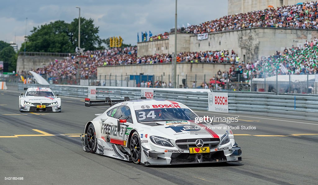 Esteban Ocon (FRA) of Mercedes-AMG DTM Team Art followed by Martin Tomczyk (GER) of BMW Team Schnitzer in the qualification for the German Touring Car Championship at the Norisring during Day 3 of the 74. International ADAC Norisring Speedweekend on June 26, 2016 in Nuremberg, Germany.