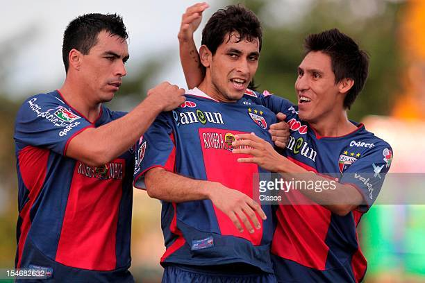 Esteban Paredes Cristian Maidana and Oscar Vera of Atlante celebrate a goal during a match between Guadalajara and Atlante as part of the MX Cup 2012...