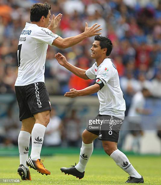 Esteban Paredes of Atlante celebrate a goal during a match between Queretaro and Atlante as part of the Torneo Apertura 2012 at La Corregidora...