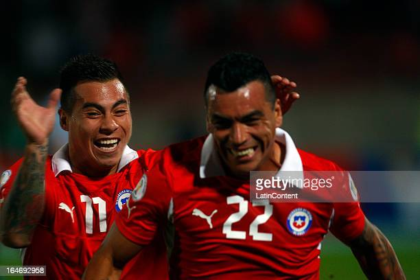 Esteban Paredes of Chile celebrates a goal against Uruguay during a match between Chile and Uruguay as part of the 12th round of the South American...