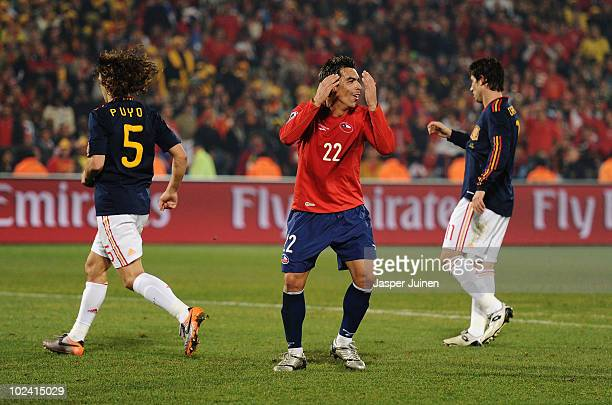 Esteban Paredes of Chile reacts to a missed chance during the 2010 FIFA World Cup South Africa Group H match between Chile and Spain at Loftus...