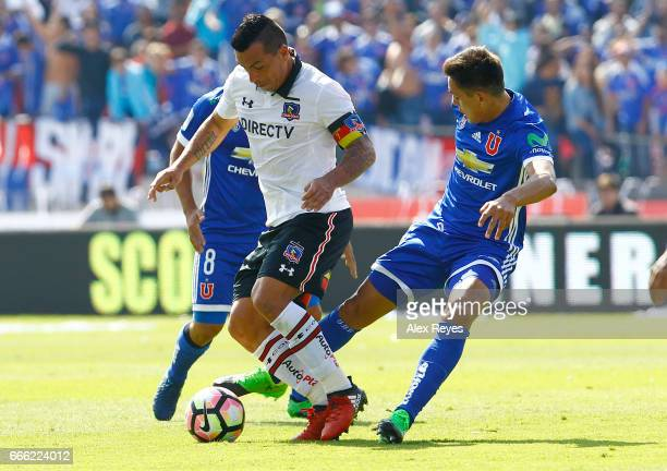 Esteban Paredes of Colo Colo fights for the ball with Matias Rodriguez of U de Chile during a match between U de Chile and Colo Colo as part of...