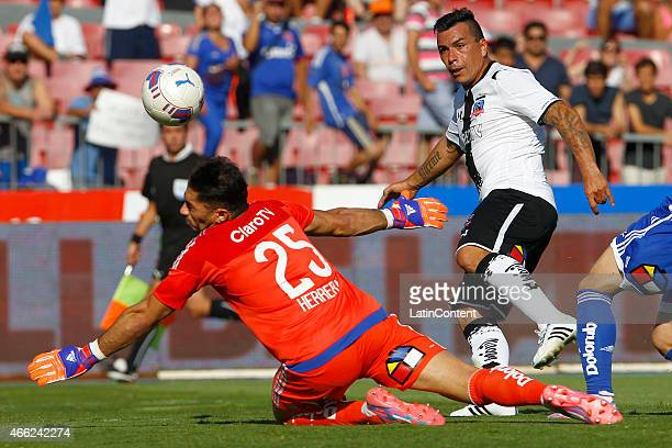 Esteban Paredes of Colo Colo struggles for the ball with Johnny Herrera of Universidad de Chile during a match between U de Chile and Colo Colo as...