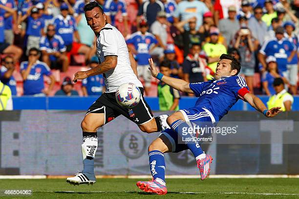 Esteban Paredes of Colo Colo struggles for the ball with Jose Rojas of Universidad de Chile during a match between U de Chile and Colo Colo as part...