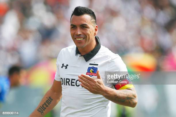 Esteban Paredes of ColoColo celebrates after scoring the third goal of his team during a match between ColoColo and U de Chile as part of Torneo...