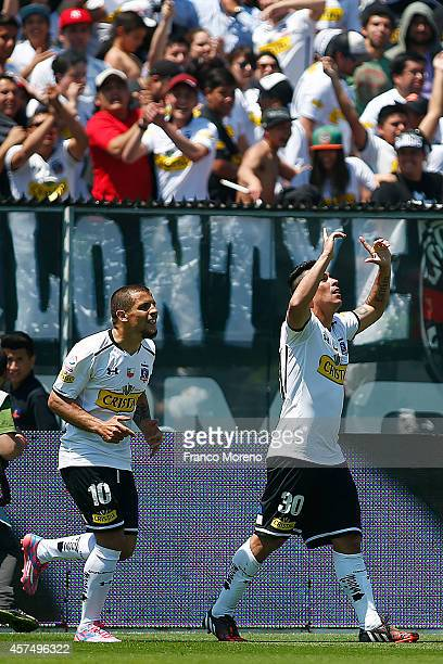 Esteban Paredes of ColoColo celebrates the opening goal against U de Chile during a match between ColoColo and U de Chile as a part of 11 round of...