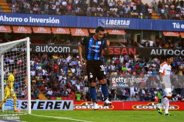 Esteban Paredes of Queretaro celebrates a goal against Jaguares during the Apertura 2013 Liga Bancomer MX at La Corregidora Stadium on August 09 2013...