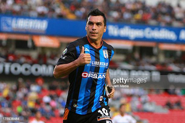 Esteban Paredes of Queretaro celebrates a goal against Jaguares during the Apertura 2013 Liga Bancomer MX at La Corregidora Stadium on August 09 2013...