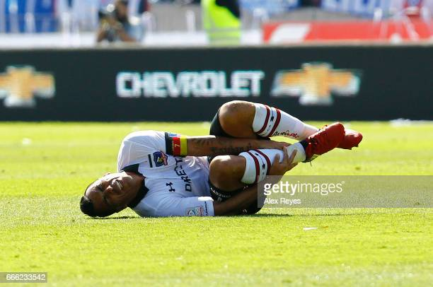 Esteban Paredes of U Colo Colo complains after an injury during a match between U de Chile and Colo Colo as part of Torneo Clausura 20162017 at...