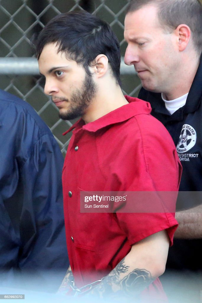Esteban Santiago is taken from the Broward County main jail as he is transported to the federal courthouse in Fort Lauderdale on Tuesday, Jan. 17, 2017. Santiago is accused of killing five people and wounding six others in the Fort Lauderdale airport shooting and faces federal charges involving murder, firearms and airport violence.
