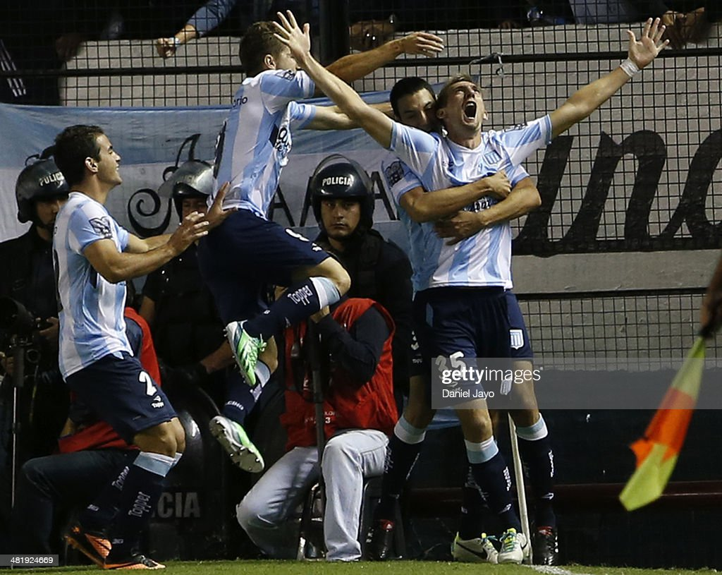 Esteban Saveljich, of Racing Club (R) celebrates with teammates after scoring the first goal of his team during a match between Racing Club and Estudiantes as part of 11th round of Torneo Final 2014 at Presidente Peron Stadium on April 1, 2014 in Buenos Aires, Argentina.