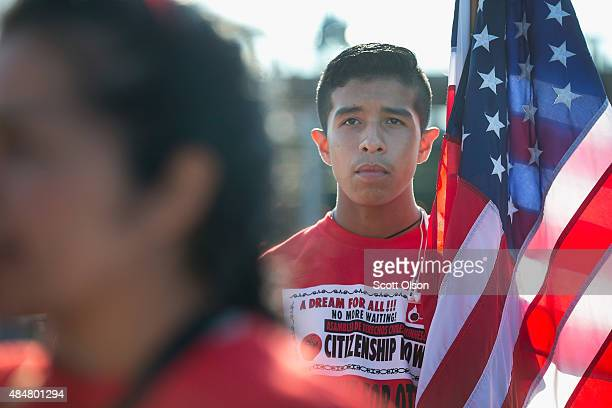 Esteban Trejo and other immigrant rights activists demonstrate outside Republican presidential candidate Sen Ted Cruz's Religious Liberty Rally on...