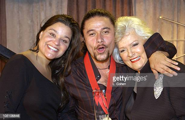 Estefano celebrates his second consecutive win as BMI Songwriter of the Year at BMI's 10th Annual Latin Awards He is flanked by BMI Ass't VP Diane...