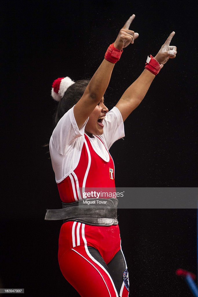 Estefany Aguirre of Peru competes in women's 53 kg as part of the I ODESUR South American Youth Games at Coliseo Miguel Grau on September 27, 2013 in Lima, Peru.
