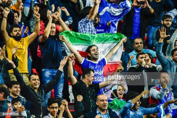 Esteghlal FC supporters attend the AFC Champions League qualifying football match between UAE's AlAhli and Iran's Esteghlal FC at AlRashid Stadium in...