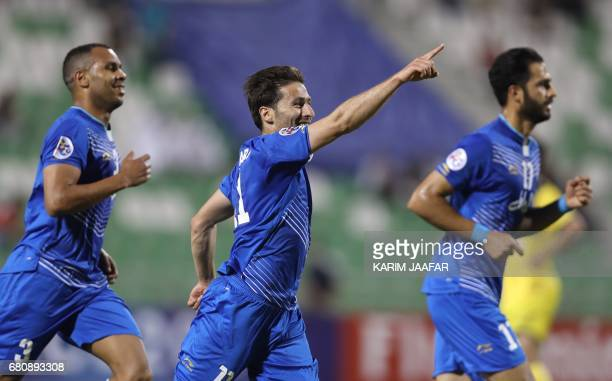 Esteghlal's forward Jaber Ansari celebrates with his teammates after scoring a goal during their Asian Champions League football match between Iran's...